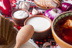 Sour cream in pottery for the borscht Stock Photo