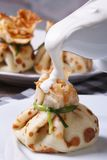 Sour cream pouring pancake on bag Royalty Free Stock Photos
