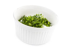 Sour cream in small round plate with herbs Royalty Free Stock Images