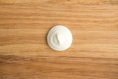 Sour Cream Swirl or White Yogurt on a Wooden Background Stock Photos