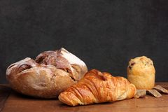 Sour dough bread croissant muffin on teak Stock Image