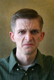 Sour Face. Man shows his disgust by pulling a sour face Royalty Free Stock Image