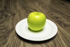 Sour Green Apple Sitting On White Plate Royalty Free Stock Image