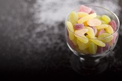 Sour jelly beans in glass cup Royalty Free Stock Photo