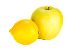 Sour lemon and sweet apple on a white background Stock Images