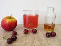Sour lemonade with sour cherries, lemon and apple vinegar Royalty Free Stock Image