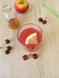 Sour lemonade with sour cherries, lemon and apple vinegar Royalty Free Stock Photos