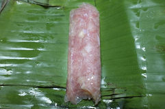 Sour pork on banana leaf package, Thai food Royalty Free Stock Photography
