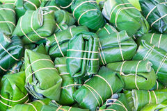 Sour pork : Thai northeastern style food in banana leaf package Stock Photography