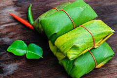 Sour pork. Thai northeastern style food which mixed pork rice garlic sugar and salt in banana leaf package Stock Images