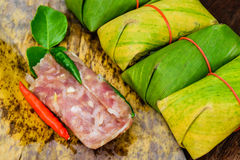Sour pork. Thai northeastern style food which mixed pork rice garlic sugar and salt in banana leaf package Stock Photo