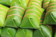 Sour pork wrapped in banana leaves in the market. Royalty Free Stock Image