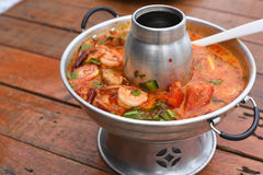 Sour prawn soup. A Sour prawn soup on table Stock Image