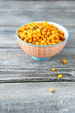 Sour sea buckthorn in a bowl Stock Photos