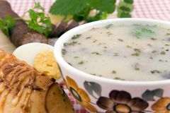 Sour soup with egg, sausage and bread. Traditional polish meal Stock Photography