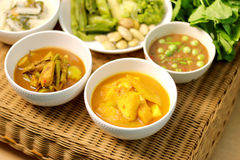 Sour soup with fish and bamboo shoot, fish organs sour soup. Chili paste, spicy thai food menu on rattan table Stock Photography