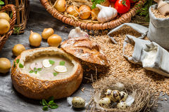 Sour soup with quail egg and fresh vegetables. On old wooden table Royalty Free Stock Images