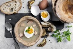 The sour soup served in bread bowl stock image