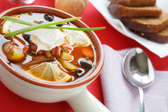 Sour soup with smoked sausage solyanka Stock Photo