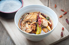 Sour and Spicy Smoked dried Fish Soup on and rice porridge wood Royalty Free Stock Photo