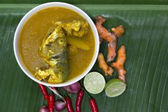Sour spicy yellow soup with fresh sea fish in white bowl on banana leaf, Sour soup made of galangal lime or Turmeric or 'Kaeng So stock photo