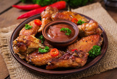 Sour-sweet baked chicken wings Royalty Free Stock Photography