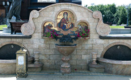 Source of holy water in the courtyard of the Temple of All Saint Royalty Free Stock Image