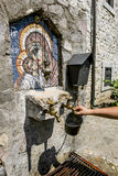 Source of holy water and an icon in a monastery on the river Mor Royalty Free Stock Images