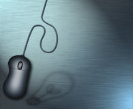 Source of Ideas. A computer mouse and shadow of light bulb Stock Photo