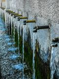 Source of 50 pipes with aged faucets. Source of 50 pipes with faucets aged and aligned stock photos
