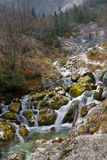 Source of Socha river in Slovenia. Autumn in mountains Royalty Free Stock Photo