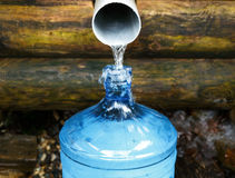 Source of spring water bottle Stock Images