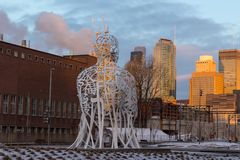 The Source statue by Jaume Plensa at sunrise, Griffintown sector, Montreal. Horizontal view of the back of The Source statue by Jaume Plensa at sunrise with Stock Image