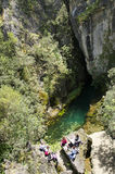 Source Su Gologone. Recognized as being a natural monument since 1988, Su Gologone is the biggest karst source in Sardinia. It gushes out right at the base of Royalty Free Stock Photo