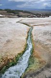 Source of Travertines at Pamakkale,Turkey. Hot springs bubbling from underground have created this wonderland of white calcium deposits. Known as the White Stock Images