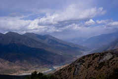 SOURCE OF YANGZI RIVER. With colorful mountains and cloud in Jan in yunnan china photo taken on: Jan 01th 2010 Royalty Free Stock Photography