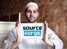 SourceForge website logo. Logo of SourceForge website on samsung tablet holded by arab muslim man. SourceForge is a Web based service that offers software Royalty Free Stock Image