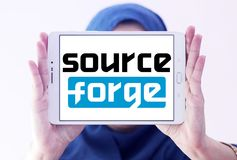 SourceForge website logo. Logo of SourceForge website on samsung tablet holded by arab muslim woman. SourceForge is a Web based service that offers software Stock Photography