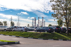 Sources of ecological intensity. Moscow, Russia - September 29, 2015: Sources of ecological intensity in the megalopolis - factory pipes and exhausts of cars Stock Image