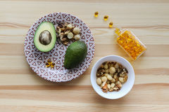 Sources of fats in the diet: avocados, nuts, omega-3 complex Stock Photography