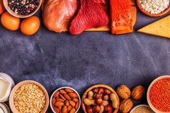 Sources of healthy protein - meat, fish, dairy products. Nuts, legumes, and grains stock photos