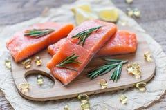 Sources of Omega-3 acid (salmon and Omega-3 pills) Stock Image