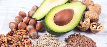 Sources of omega 3 fatty acids contained in the food. Sources of omega 3 fatty acids: flaxseeds, avocado, walnuts and sunflower Royalty Free Stock Images