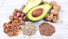 Sources of omega 3 fatty acids contained in the food. Sources of omega 3 fatty acids: flaxseeds, avocado, walnuts and sunflower royalty free stock image