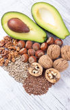 Sources of omega 3 fatty acids contained in the food. Sources of omega 3 fatty acids: flaxseeds, avocado, walnuts and sunflower Stock Photography