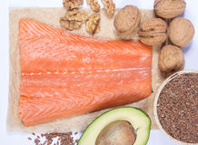 Sources of omega 3 fatty acids: flaxseeds, avocado, salmon and walnuts Royalty Free Stock Photos