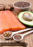 Sources of omega 3 fatty acids: flaxseeds, avocado, salmon and walnuts Stock Image