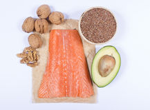 Sources of omega 3 fatty acids: flaxseeds, avocado, salmon and walnuts Stock Photography