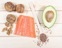 Sources of omega 3 fatty acids: flaxseeds, avocado, salmon and walnuts Royalty Free Stock Photography