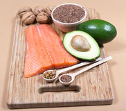 Sources of omega 3 fatty acids: flaxseeds, avocado, salmon and walnuts Royalty Free Stock Images